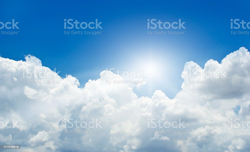 blue sky with cloud and sunbeam in summer stock photo