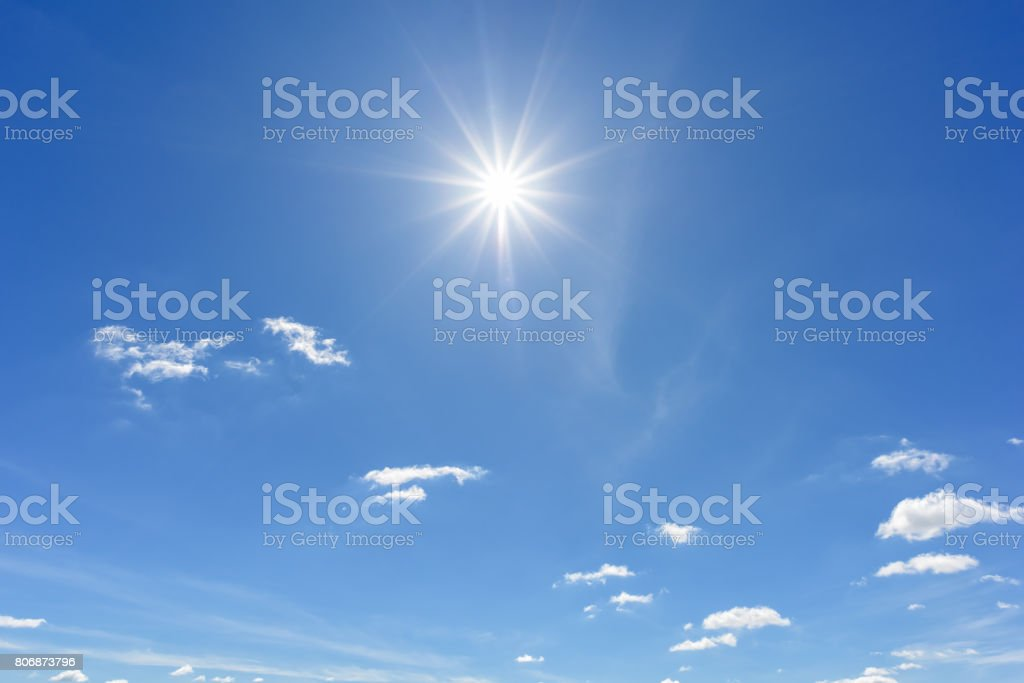 Blue sky with clouds and sun reflection. looking up view stock photo