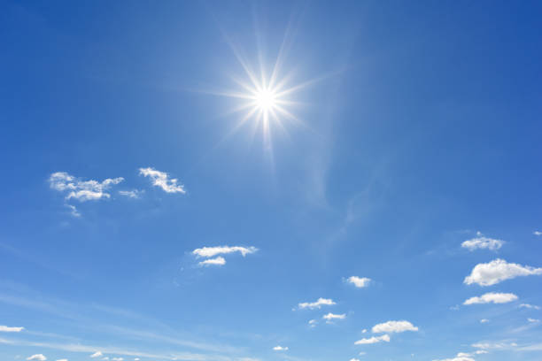 blue sky with clouds and sun reflection. looking up view - clear sky stock pictures, royalty-free photos & images