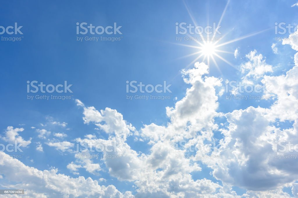 Blue sky with clouds and sun reflection stock photo