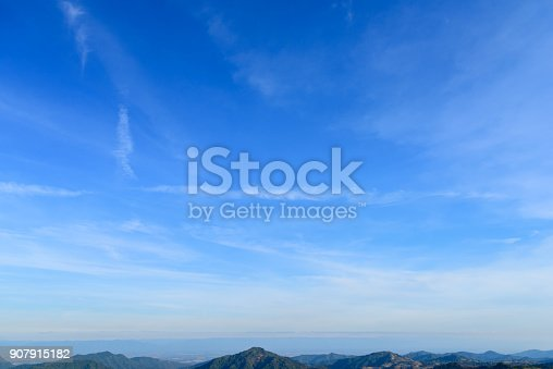 istock Blue sky with clouds. Looking up view 907915182