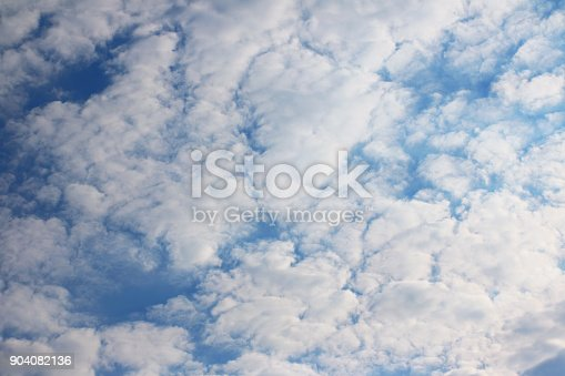 istock Blue sky with clouds 904082136