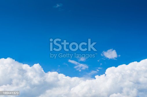 istock Blue sky with dramatic white clouds below 155441370