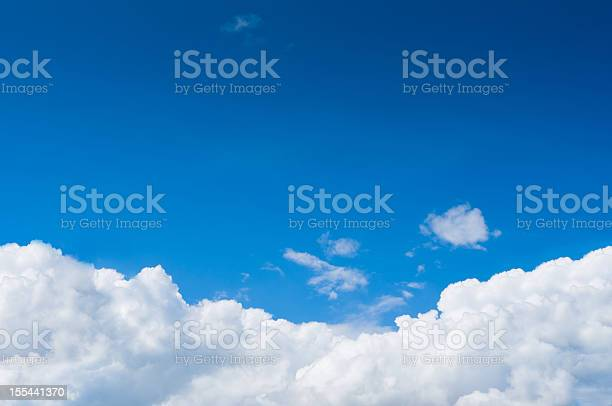 Photo of Blue sky with dramatic white clouds below