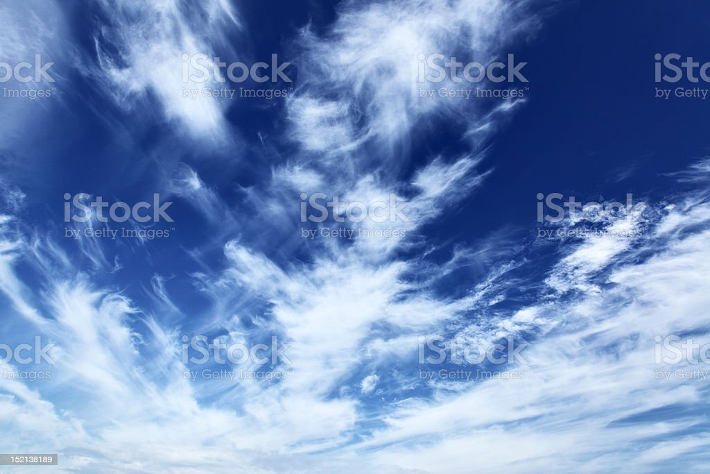 Blue sky with fleecy clouds royalty-free stock photo