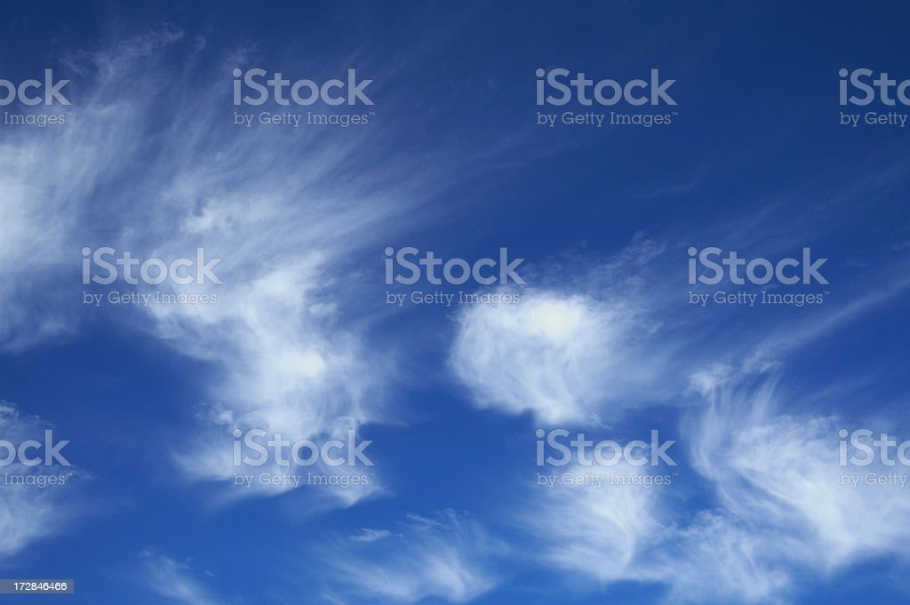 Blue sky with fluffy clouds royalty-free stock photo