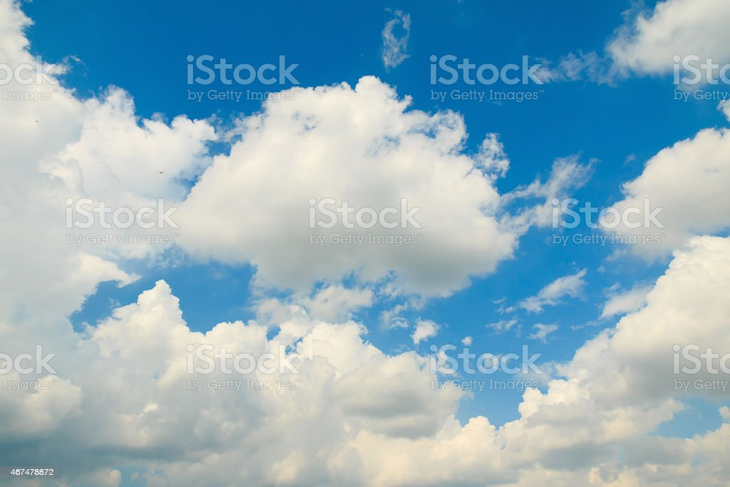 Blue sky with fluffy white clouds stock photo