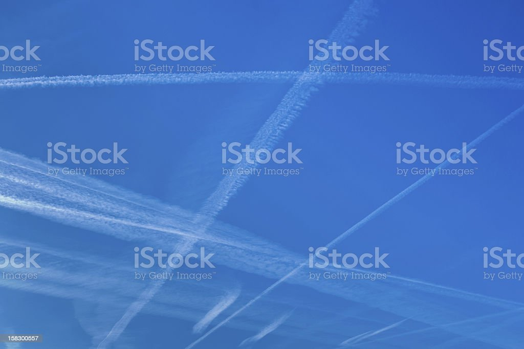 blue sky with lines from aircraft royalty-free stock photo