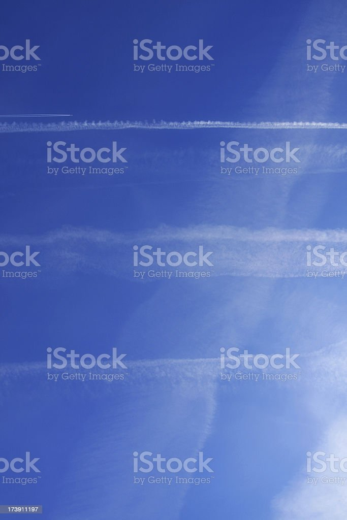 Blue Sky with Plane Stripes royalty-free stock photo
