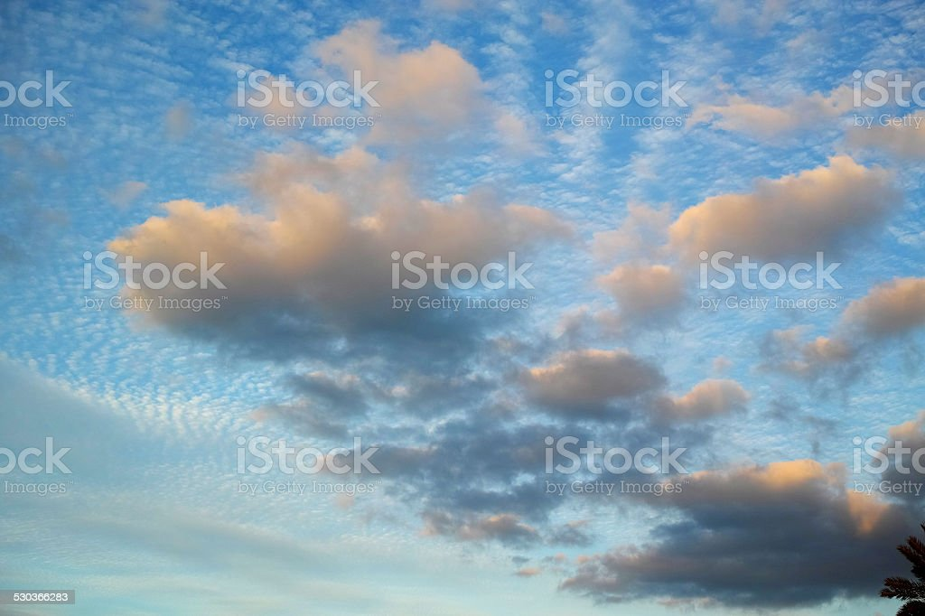 Blue Sky With Puffy Clouds stock photo