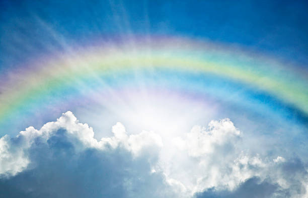 Blue Sky With Rainbow and Sun Reflection stock photo