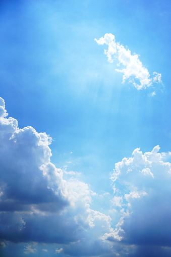 White clouds and bright blue sky background