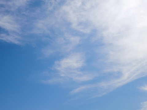 1010238190 istock photo Blue sky with scattered clouds 1142854917