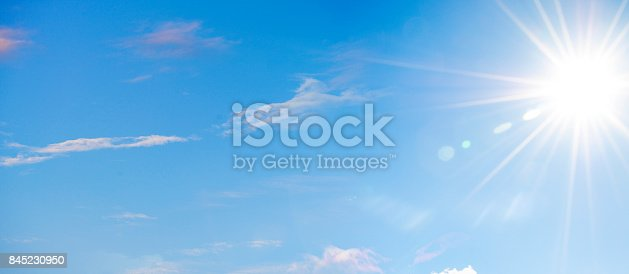 istock Blue Sky with Soft Clouds and Sun 845230950