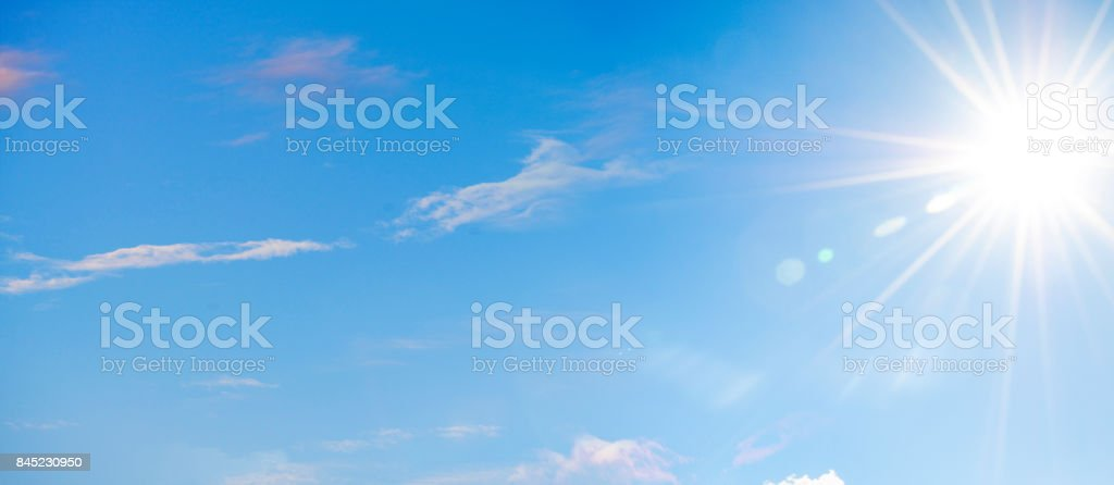 Blue Sky with Soft Clouds and Sun stock photo