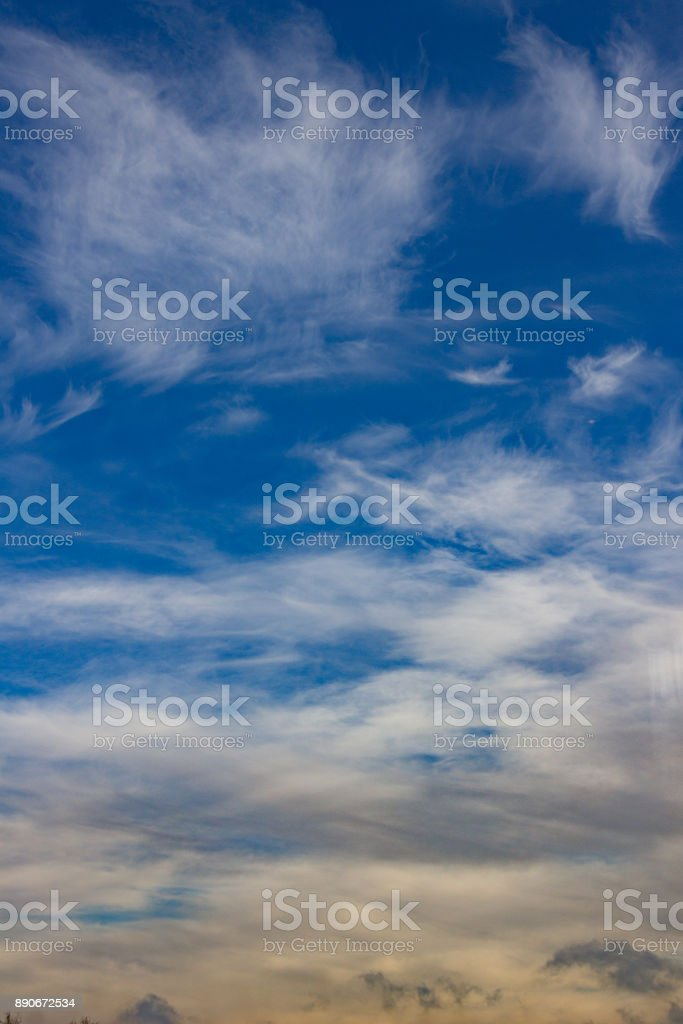 Blue sky with soft clouds. Vertical orientation. stock photo