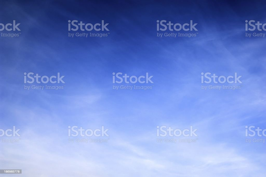 Blue sky with some clouds background stock photo