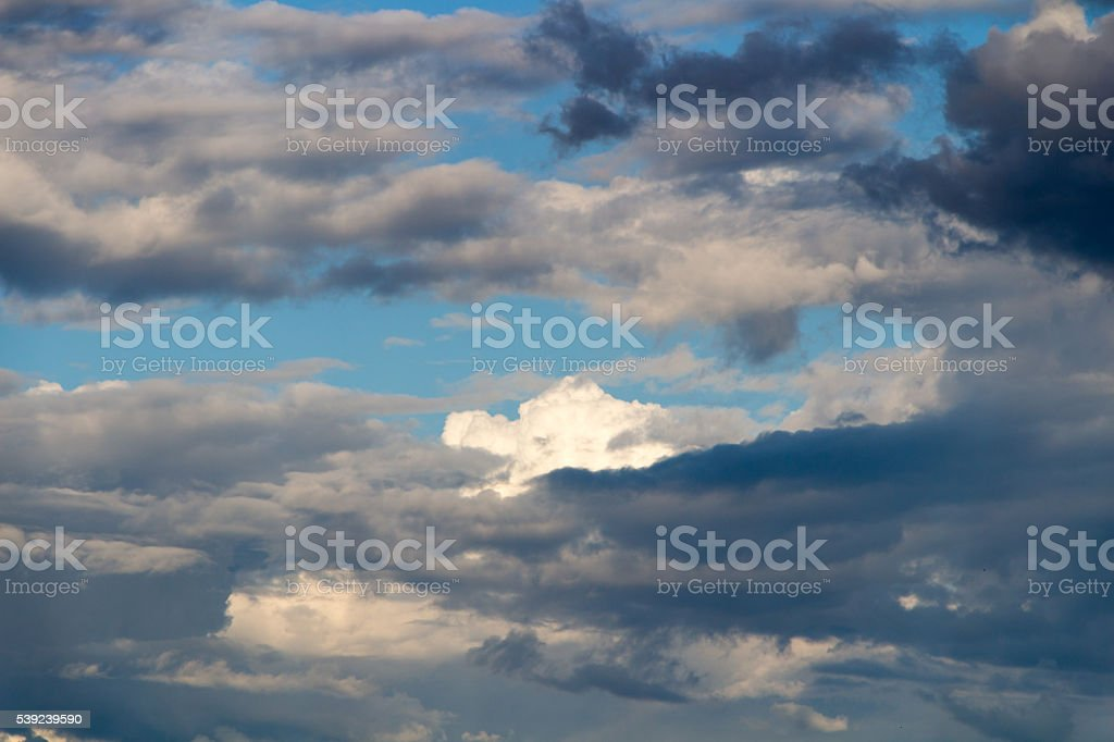 Blue sky with stormy clouds in the summer day royalty-free stock photo
