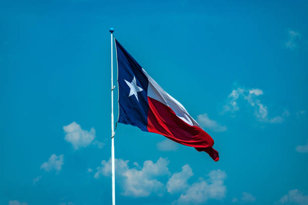 Blue sky with Texas flag stock photo