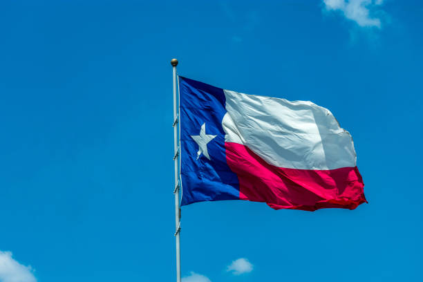 blue sky with Texas state flag stock photo