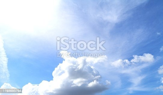 istock blue sky with white clouds background, appropriate the background , idea for copy space. 1193693794