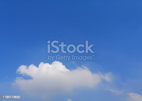istock blue sky with white clouds background, appropriate the background , idea for copy space. 1195170632