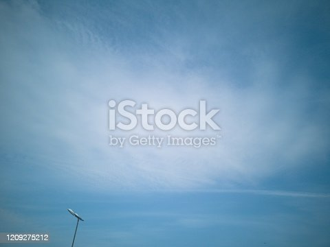 istock blue sky with white clouds background, appropriate the background , idea for copy space. 1209275212