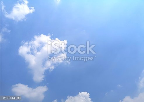 istock blue sky with white clouds background, appropriate the background , idea for copy space 1211144193