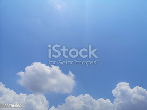 istock blue sky with white clouds background, appropriate the background , idea for copy space 1222784930