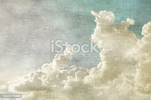 Blue sky with white clouds in retro grunge style. Nature background.