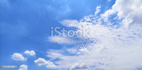 istock blue sky with white clouds nature background, appropriate the background 1242553621