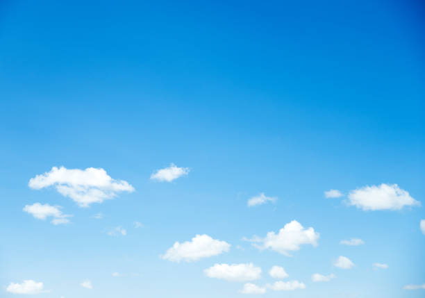 Blue sky with white clouds stock photo