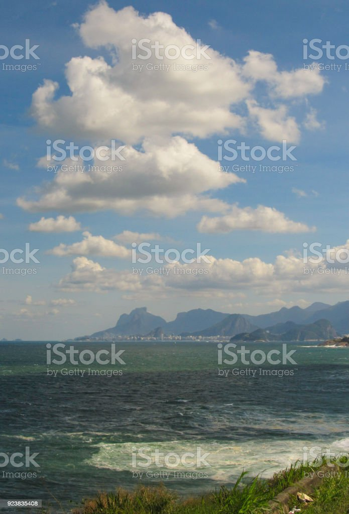 Blue sky with white fluffy clouds stock photo