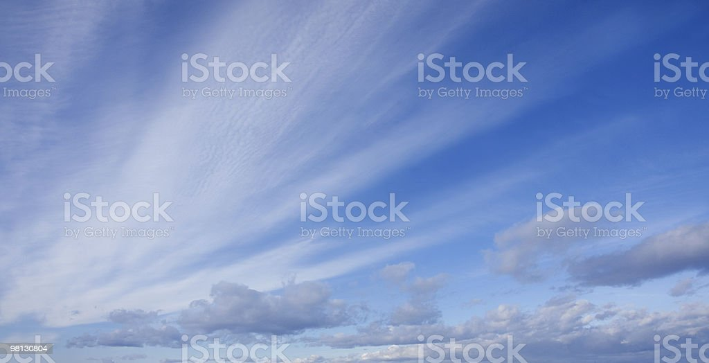 Blue sky with white fluffy clouds royalty-free stock photo