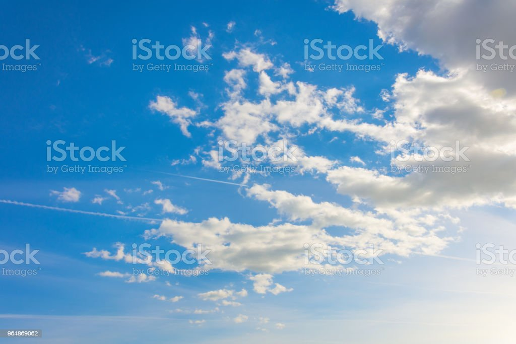 Blue sky with white summer cumulus clouds. royalty-free stock photo