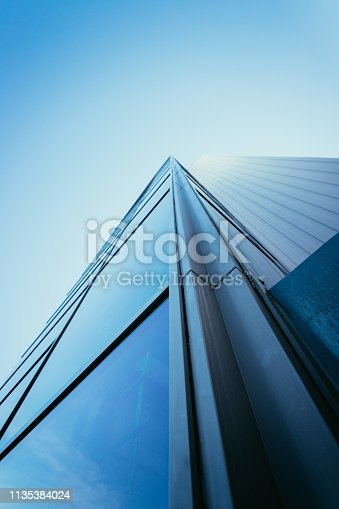 istock Blue skyscraper out of glass 1135384024