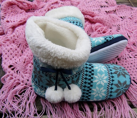 Blue slipper boots and pink tasseled hand knitted shawl wrap