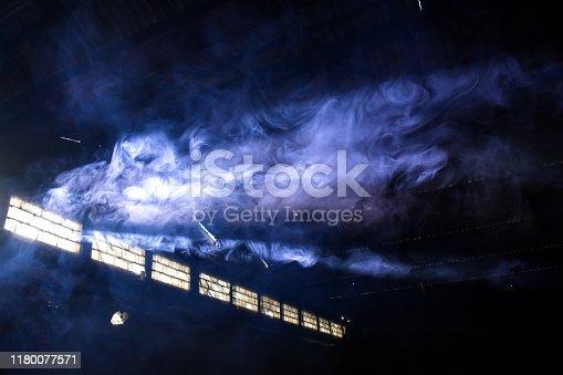 blue smoke bomb exploding cloud in deserted empty hangar