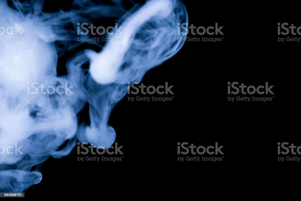 blue smoke isolated on a black background. fractal. spiral. stock photo