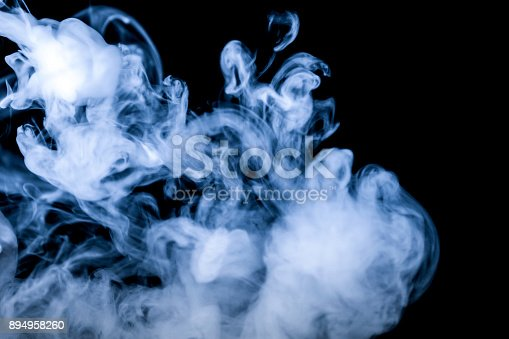 istock blue smoke isolated on a black background. fractal. spiral. 894958260
