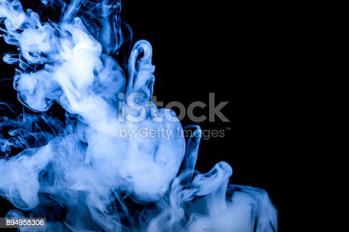 874895030istockphoto blue smoke isolated on a black background. fractal. spiral. 894958306
