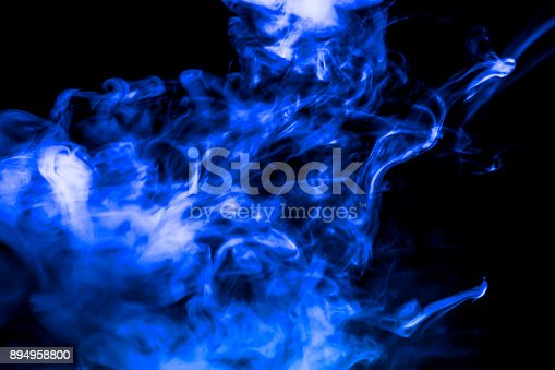 874895030istockphoto blue smoke isolated on a black background. fractal. spiral. 894958800