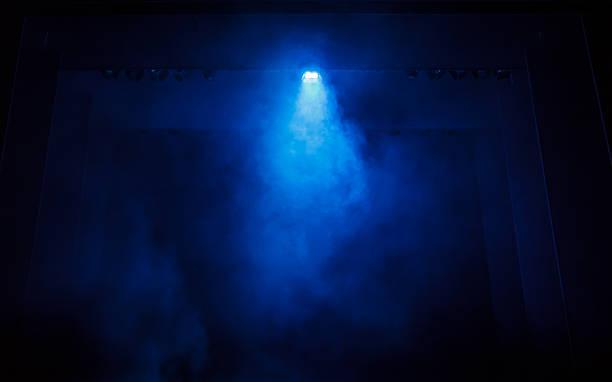 Blue Smoke on a Black Stage stock photo