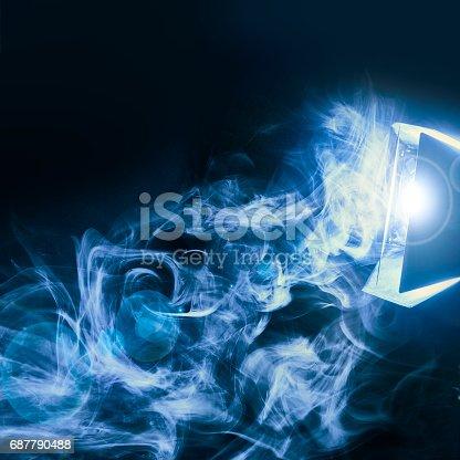 istock Blue smoke on black background lit by flashgun 687790488