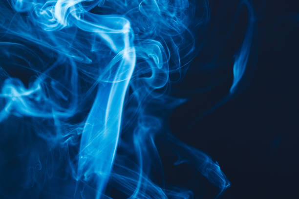Blue Smoke on Black Abstract shot of a blue smoke on black background. fire natural phenomenon stock pictures, royalty-free photos & images