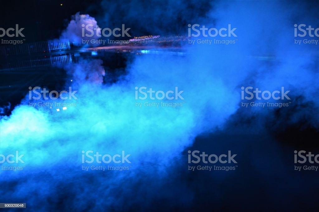 Blue smoke on water stock photo