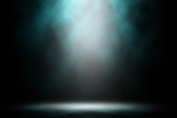 Blue smoke show on stage night dark studio  background. stock photo