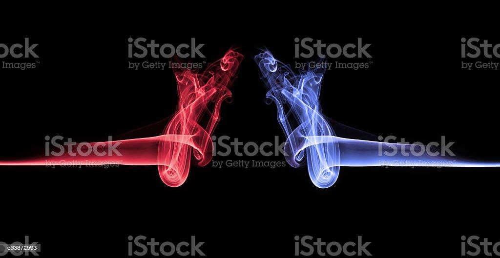 Blue smoke vs red smoke abstract stock photo