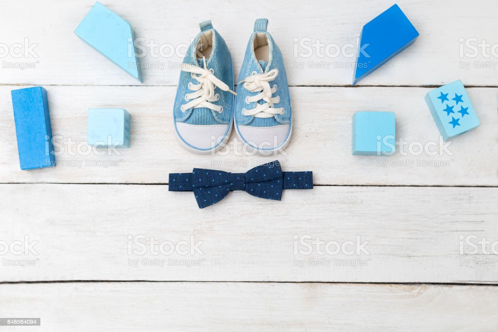 Blue sneakers and a bow tie for a boy. View from above stock photo