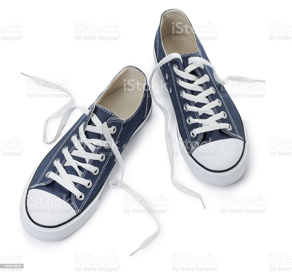 Blue Sneakers on a White Background stock photo